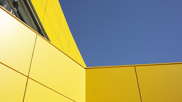 Yellow tiled building and blue sky